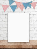 Blank white board and party flags hanging on white brick wall ba Royalty Free Stock Photos