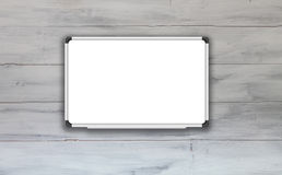 Blank white board with white wooden wall background Stock Photo