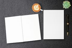 Blank hardcover canvas book mock up for design book cover on black table Stock Photography