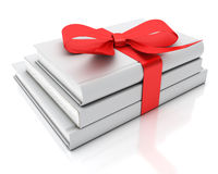 Blank white books as gift with red ribbon isolated on white background Royalty Free Stock Image