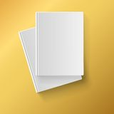 Blank white  books on yellow background Stock Photography