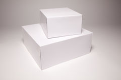 Blank White Box on Grey. Blank White Box Isolated on a Grey Background Ready for Your Own Graphics Stock Photography