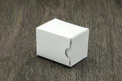 Blank white box mockup. On wood background Stock Photos
