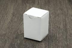 Blank white box mockup. On wood background Royalty Free Stock Photo