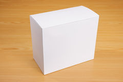 Blank white box on wood background royalty free stock photography