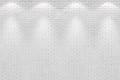 Blank white brick wall lit by four spot lights Royalty Free Stock Photography
