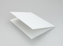 Blank white brochure on a gray background. 3d rendering Stock Images