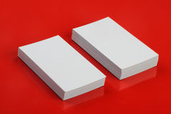 Blank White Business Card for Mockup on Red Stock Images