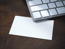 Blank white business card under keyboard Stock Image