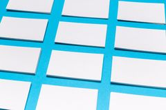 Blank white business cards on blue background. Mockup for branding identity royalty free stock photo
