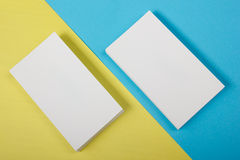 Blank white business cards on color background Stock Photos