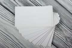 Blank white business cards on wood background Stock Images