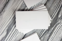 Blank white business cards on wood background Royalty Free Stock Image