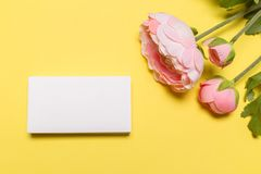 Blank white business cards on yellow background. Mockup for branding identity stock photos