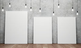 Blank white canvas with glowing light bulbs Stock Image