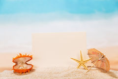 Blank white card,  casket with  pearl and starfish in  sand. Royalty Free Stock Photos