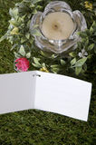 Blank white card on grass Stock Images