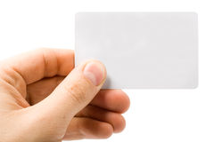 Blank white card in hand Stock Images