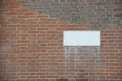 Blank white clay tablet on of red brick wall. Stock Photos