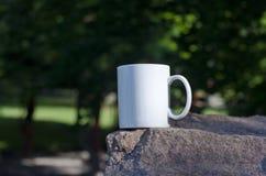 A blank white coffee mug on the stone edge stock photos