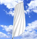 Blank white convex feather flag outdoor advertising shield flag banner or vertical wind banner mock up template. Blank white convex feather flag outdoor Stock Photo
