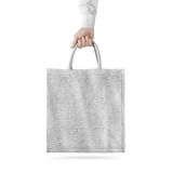 Blank white cotton eco bag design mockup , holding hand. Clipping path. Textile cloth bag mock up template hold arm. Tote shoe consumer reusable organic craft royalty free stock photo