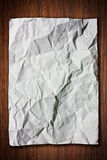 Blank White Crumpled paper on wood wall. Blank White Crumpled paper on wood background royalty free stock image