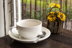 Blank white cup with a teaspoon on the table Stock Images