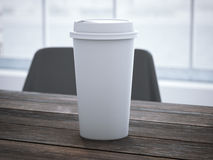 Blank white cup on the wooden table. 3d rendering Royalty Free Stock Photos