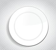 Blank white dinner plate over a cloth Stock Photos