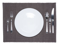 Blank white dish, fork, spoon and knife Stock Photos
