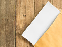 Blank white document paper in openning brown paper envelope Royalty Free Stock Image