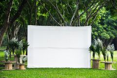 Blank white empty space big screen advertising banner fabric mock up template in outdoor green tropical garden public park. Advertisement announcement stock images