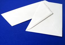 Blank White Envelope. Front and back, blue background stock images