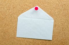 BLANK WHITE ENVELOPE ON CORKBOARD Stock Images