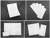 Blank white folding paper flyer on gray background Royalty Free Stock Image