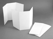 Blank white folding paper flyer. Identity design, corporate templates, company style, set of booklets, blank white folding paper flyer Royalty Free Stock Images