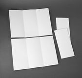 Blank white folding paper flyer Stock Images