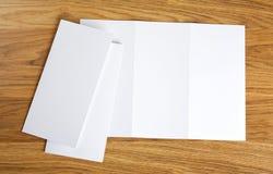 Blank white folding paper flyer. Identity design, corporate templates, company style, set of booklets, blank white folding paper flyer Royalty Free Stock Photo