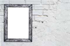 Blank white frame on brick wall background with copy space. Royalty Free Stock Images