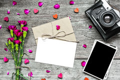 Blank white greeting card with blank photo and retro camera with flowers Royalty Free Stock Photo