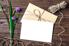 Blank white greeting card and envelope with purple wildflowers Royalty Free Stock Images