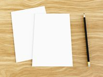 Blank white greeting card mockup with pencil on wooden table, 3D rendering. Blank white greeting card mockup with pencil on wooden table, angled top view, 3D Royalty Free Stock Photography