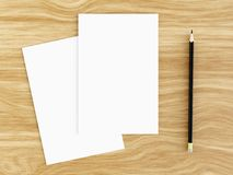 Blank white greeting card mockup with pencil on wooden table, 3D rendering. Blank white greeting card mockup with pencil on wooden table, top view, 3D rendering Stock Images
