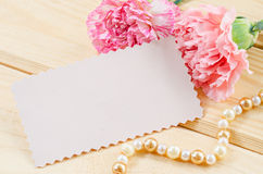 Blank white greeting card with pink Carnation flower. Royalty Free Stock Photo