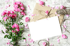 Blank white greeting card with pink rose flowers bouquet Stock Images