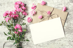 Blank white greeting card with pink rose flowers. mock up Royalty Free Stock Image