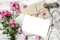 Blank white greeting card with pink roses bouquet and envelope Stock Photography