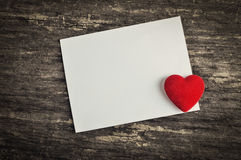 Blank white greeting card with red heart Royalty Free Stock Image
