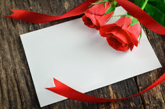 Blank white greeting card with red roses Stock Photos
